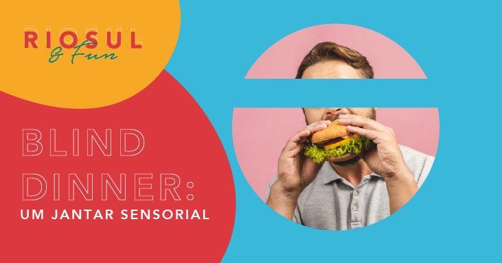 Composição de uma imagem com fotografia e texto. Do lado direito, fotografia redonda de um homem a comer um hambúrguer. A zona dos olhos foi eliminada ficando o circulo dividido em duas metades. Do lado esquerdo, o texto Blind Dinner:um jantar sensorial.